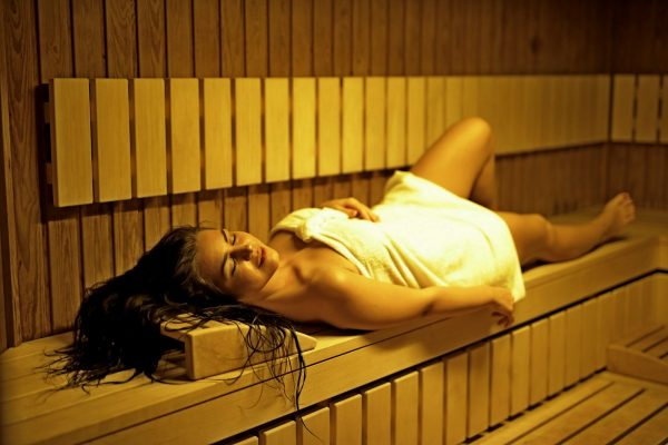beautiful-woman-sitting-in-sauna